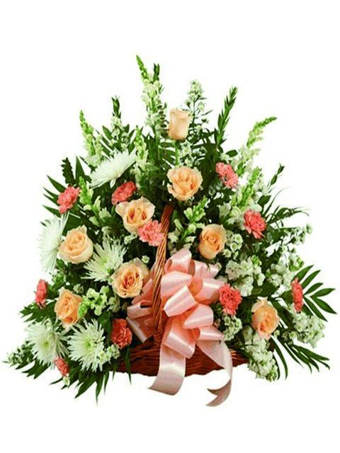 Cesto funebre di fiori misti tenui