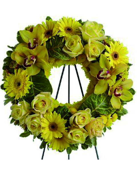 Corona di rose orchidee e fiori gialli